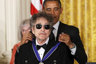 President Barack Obama presents rock legend Bob Dylan with a Medal of Freedom at the White House in Washington. Photo / AP