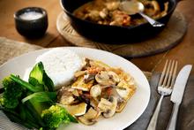 Braised chilli mushrooms with crispy tofu and greens. Photo / Babiche Martens