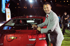 Manchester United's Ryan Giggs signs a Chevy Malibu. Photo / Supplied