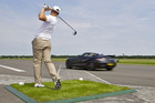 Pro golfer Jake Shepherd hits a flying ball for race star David Coulthard to catch in a luxury Mercedes-Benz Roadster. Photo / Supplied