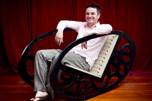 Justin Newcombe in his finished throne rocking chair. Photo / Natalie Slade