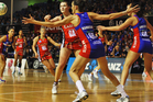 Anna Harrison of the Mystics defends against Ellen Halpenny of the Tactix. Photo / Getty Images