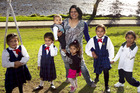 Ranjna Patel with her grandkids Samiya Patel (8), twins Neela and Ayaana Patel (6), Mia Reddy (5), Sonia Reedy (3) and Jayan Patel (8months) at the Rotary Walkway. Photo / Natalie Slade