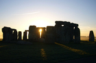 Dawn breaks over Stonehenge. Photo / Jim Eagles
