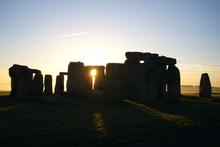 Dawn breaks over Stonehenge. Photo / Jim Eagles
