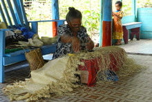 Taumuli Salu keeps alive the Samoan tradition of fine-mat weaving in her village of Palauli Photo / Dan Ahwa
