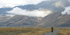A cyclist heads towards Lake Pukaki in Mt Cook National Park on the Alps 2 Ocean Cycle Trail. Photo / John Parker