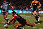 Asaeli Tikoirotuma of the Chiefs dives over to score a try during the round 15 Super Rugby match between the Blues and the Chiefs at North Harbour Stadium. Photo / Getty Images.