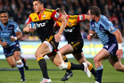 Sonny Bill Williams of the Chiefs in full flight against the Blues at North Harbour Stadium. Photo / Getty Images.