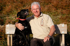 Sir Michael Cullen with his dog  Crumble  at his home at Ohope Beach. Photo / Christine Cornege