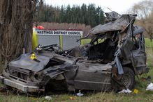Four people died when this vehicle left a Hawke's Bay road, hit a poplar tree and landed in a paddock, 2km up Waikare Rd, Putorino. Photo / Duncan Brown
