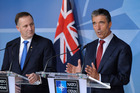 John Key with Nato Secretary-General Anders Fogh Rasmussen at the signing of a partnership agreement in Brussels. Photo / NZ National Party