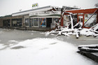 The snow forced a halt to the demolition of the shops on Breezes Road in Christchurch. Photo / Supplied