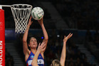 Anna Harrison of the Mystics put netball on the front pages after being hoisted repeatedly to block shots from the Melbourne Vixens during their match last month in Melbourne. Photo / Getty Images.