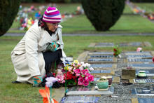 Aynsley Harwood visits the grave of her daughter Louisa. She says the parole process re-victimises her. 'I don't, can't get over it.' Picture / Simon Baker