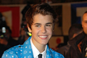 Justin Bieber has done himself some damage after crashing in to a glass wall. Photo / AP