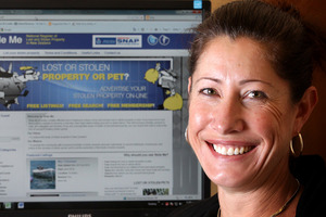 Angela Thomas, Business Developement Manager of Stole Me Ltd, pictured in Tauranga today front of a webpage from her new site Stole Me. Photo / The Daily Post