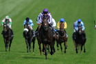 Camelot, centre, ridden by Joseph O'Brien wins Epsom Derby during Derby Day. Photo / AP