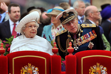 Queen Elizabeth II and Prince Philip watch the proceedings from the royal barge during the Diamond Jubilee Pageant. Photo / AP