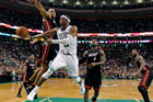Boston Celtics' Rajon Rondo dumps off the ball as he is pressured by Miami Heat's Shane Battier during game four in the NBA basketball Eastern Conference finals playoffs series. Photo / AP