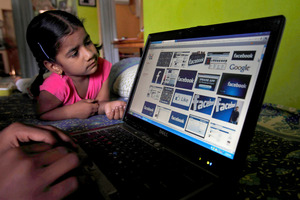 Facebook said that it is testing out ways to allow younger children to use the site. Photo /AP