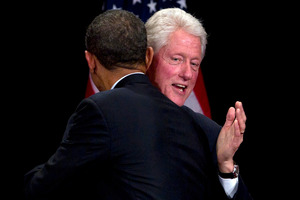 Bill Clinton greets Barack Obama at a campaign gala at the Waldorf Astoria hotel yesterday. Photo / AP