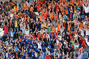Some in this crowd who turned out to watch the Netherlands' public training session were less than supportive - according to Dutch skipper Mark van Bommel. Photo / AP