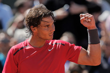Rafael Nadal of Spain celebrates winning his semi final match against compatriot David Ferrer at the French Open. Photo / AP