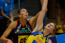 Magic shooter Irene van Dyk competing for the ball with Pulse defender Katrina Grant during last year's competition. File photo / Christine Cornege