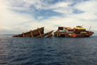 The Rena's battered skeleton makes a sorry sight after months of being hammered by the sea. Photo / File