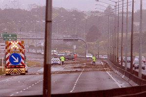 Debris from flooding covered the North Western Motorway after a similar day of heavy wind and rain in 2011. Photo / Dean Purcell