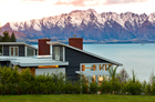 Matakauri Lodge's expansive windows bring that magnificent view of Lake Wakatipu and mountains seemingly indoors. Photo / Miz Watanabe