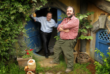 Sir Peter Jackson shows Prime Minister John Key around a 'hobbit house'. Photo / Alan Gibson