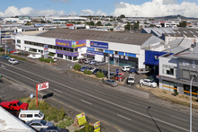 The Great Sth Rd property that will be renovated and then offered for lease or sale and three of the Jones Lang LaSalle men involved. Photo / Supplied