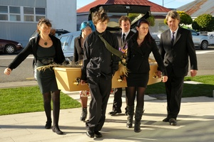 Mother Sue Cameron, Melissa, 21, James, 19, Kyle, 22, Crystal, 17, and father Angus carry their son and sibling Robbie's coffin into the Carterton Events Centre. Photo / APN