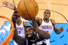 Oklahoma City Thunder power forward Serge Ibaka, right rear, from the Republic of Congo, blocks a shot by San Antonio Spurs forward DeJuan Blair as Kevin Durant (35) watches. Photo / AP