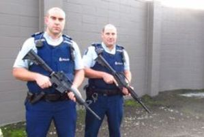 BB guns are being mistaken for real firearms. Sergeant Harry Harvey (left) has a police issue gun, while Constable Mike Hayward has a recently confiscated BB gun. Photo / Sonya Bateson
