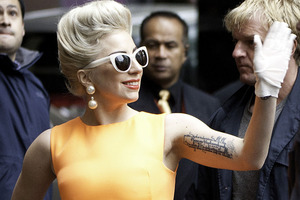 Lady Gaga took the time to hug fans and give autographs. Photo / Richard Robinson