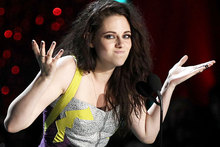 Kristen Stewart says she likes her trademark scowl.