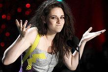 Kristen Stewart says she likes her trademark scowl.