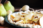 Vanilla ice cream goes perfectly with the pear, creme fraiche and walnut crumble tart. Photo / Doug Sherring