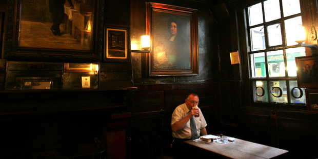 A patron sips his beer in the Ground Bar of Ye Olde Cheshire Cheese at 145 Fleet St. The Victorian London of Charles Dickens can still be seen, touched and smelled in places such as this. Photo / Bloomberg News