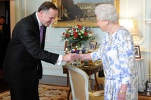 Britain's Queen Elizabeth II shakes hands with New Zealand's Prime Minister John Key at Buckingham Palace in London on June 6, 2012. Photo / AFP