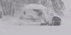 Watch: Big blast of snow traps travellers in Arthur's Pass 