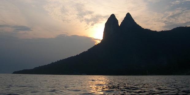 The sun sets behind the dragon's ears on Tioman Island, Malaysia. Photo / Jim Eagles