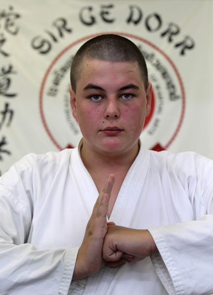 Yellow belt Lane Conroy 15 from New Lynn has been studying the martial art discipline of 'Sir Gee Dorr' Kung Fu for two years under Charlie Tamati who offers the programme 'Te Aratika' (The Pathway) for troubled youths.