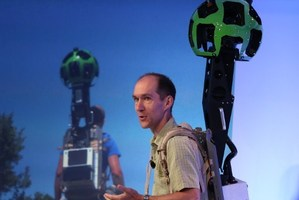 Luc Vincent, Google Engineering Director for Street View, demonstrates a backpack camera called Trekker. Photo / AFP