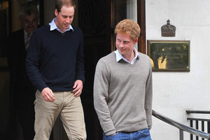 Princes William and Harry leave the hospital after visiting their grandfather. Photo / Clive Gee