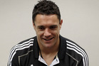 Dan Carter has quickly found a rapport with new All Blacks halfback Aaron Smith. Photo / Getty Images.