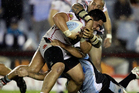 Konrad Hurrell of the Warriors is tackled by the Sharks defence during the round 15 NRL match between the Cronulla Sharks and the New Zealand Warriors. Photo / Getty Images.
